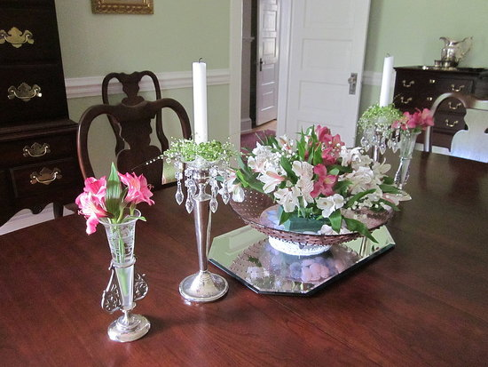 antique crystal vases and candlesticks with new springtime flowers